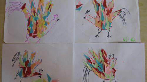 我们将彩色纸贴在画的小手里,再用水彩笔画上眼睛,鼻子,嘴巴,看小手