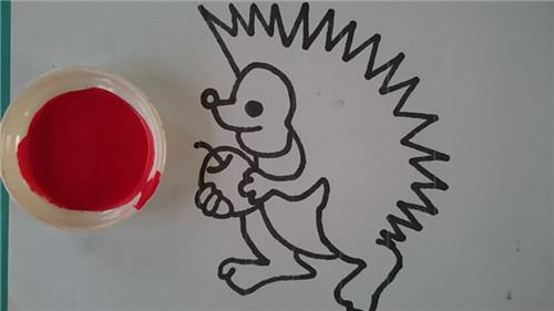 活动目标: 1,掌握手指点画的方法,以点的形式让小刺猬背果子.图片